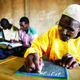 A man taking a literacy class in Burkina Faso