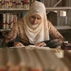 Arab girl in head dress, studying in library