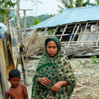 A woman and a child in front of a destroyed house in Bangladesh