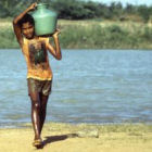 Boy carrying water