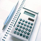 Calculator, pen and calendar