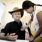 A man in Latin America is tested for Chagas disease by an MSF doctor