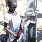 A child drawing water at a well in South Sudan