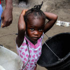 A child during the rainy season in West Africa