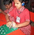 A child at the Mathru school using the Braille tutor