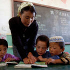 Teacher and children in classroom, China