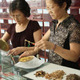Women weighing Chinese medicine