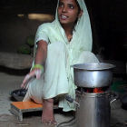 A woman with a clean cooking stove