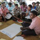 WCS staff working with Kubulau community members to adapt their management plan