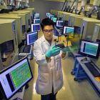 A researcher among a bank of DNA analysis machines