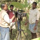 A farmer is filmed doing a demonstration in Karnataka