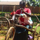 Disabled person using wheelchair in Uganda