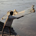 A fisherman on the Mekong River