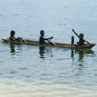 Young boys fishing off the coast of Papua New Guinea