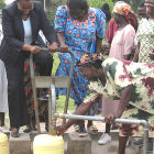Women operating foot water pump in Kenya