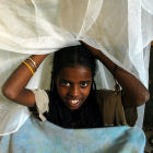 Girl with bed net, Ethiopia