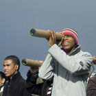 People looking through a homemade telescope