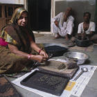 Woman makes Ayurvedic herbal pills