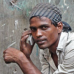 A man talks on a mobile phone/India