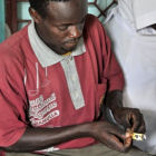 A man taking TB drugs in Tanzania, Africa