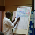 Taking notes at meeting in Nairobi, Kenya