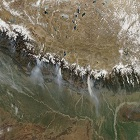 On March 12, 2009, the Moderate Resolution Imaging Spectroradiometer (MODIS) on NASA's Aqua satellite caught a glimpse of a relatively rare event: large–scale forest fires in the Himalaya Mountains of