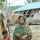 People with house damage from cyclone Sidr, Bangladesh.