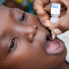 Child receiving oral polio vaccine in Kano, Nigeria
