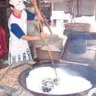 A man cooking rice in Vietnam