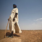 A herder in Mauritania searches in vain for fertile grazing land