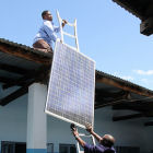 Men installing solar panels in Tanzania