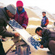 Men setting up solar panels in rural village