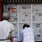 Reading newspapers in Hanoi, Vietnam