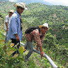 Men working on a water pipeline in Honduras