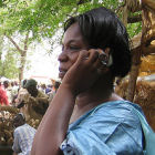 A woman using a mobile phone in rural Africa