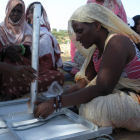 Women installing solar panels