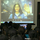 Women scientists at a conference in India speaking to astronaut Sunita Williams