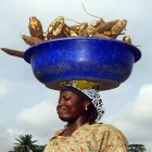 Woman carrying cassava