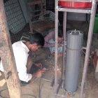 Setting up an arsenic removal filter in an iron container, Bangladesh
