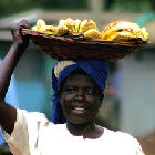 Woman carrying bananas