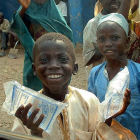 Boy carrying clean water in Nigeria