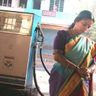 Woman at diesel station