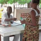 A patient is given TB drugs in Cotonou, Benin