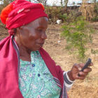 A woman holding a mobile phone