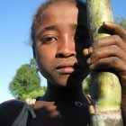 Girl with sugar cane
