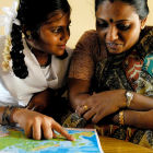 Indian girl and her mother look at a map