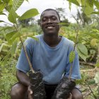 Ivorian cocoa farmer with plants