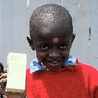 Kenyan child with antiretroviral drugs