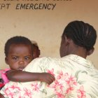 Mother signing baby into hospital in Kenya