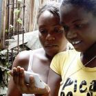 Two women look at mobile phone